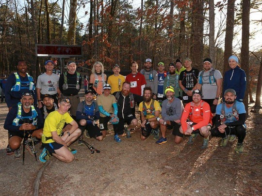 Rusty Harvey, second from right in front row, poses with the rest of the competitors in the LOViT 100-mile race.