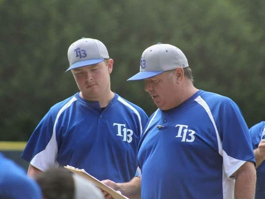 American Legion Post 13 manager Doug Treadway talks to his team as Jacob Dempsey looks on.