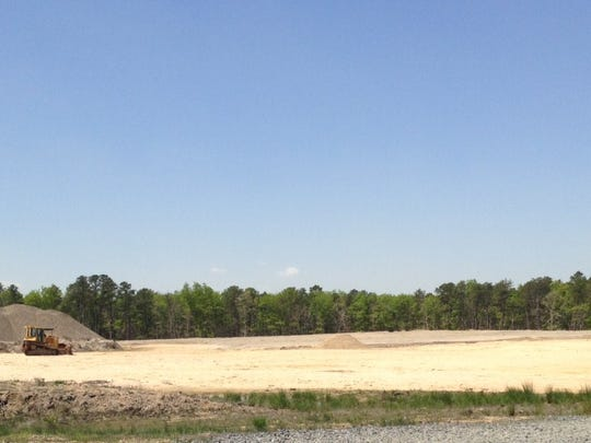 Barnegat Crossings  (152 apartments, 35 stores)  eventually will  be on this dirt field .