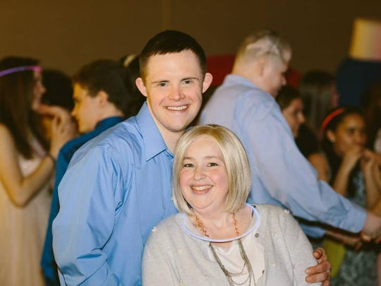 Daniel Noltemeyer, 32, with his girlfriend. Noltemeyer is a finalist for the Betty Jane France Humanitarian Award.