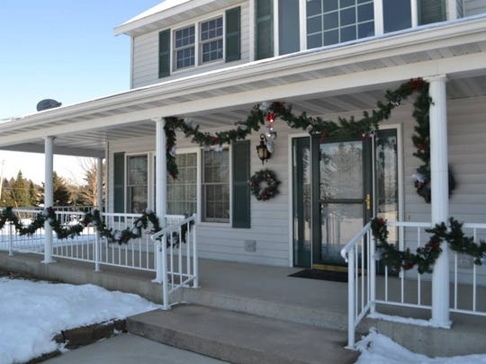 Exterior of the home of Rita King decorated for the holiday season for the 2013 Holiday Home Tour.