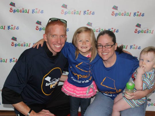 Robert and Staci Warden are running the Murfreesboro Half Marathon for Special Kids Team Chloe. Robert and Staci pose for a picture with Chloe and their son, Bennett, at a Special Kids event.