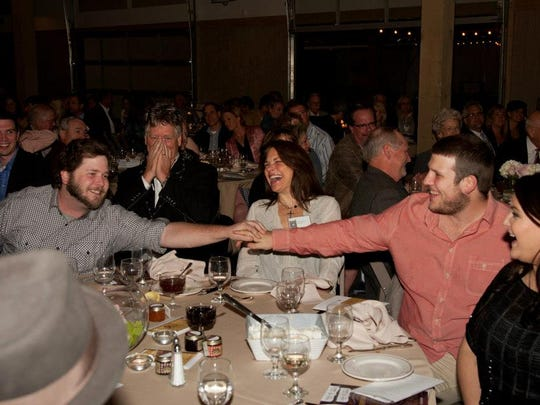 "From left, Ryan, John, Dawn and Jason Huie attend the 2013 Hope Clinic for Women fundraiser dinner. The charity director said to tell the person next to you that he or she matters. Together, brothers Ryan and Jason turned to each other and said, ""You don't matter!"" Then they laughed and fist bumped."