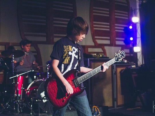 Shane Voss plays lead guitar for Cross The Line.