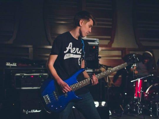 Keegan Hall plays bass for Cross The Line.