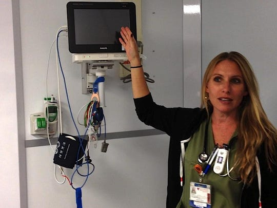 Sarah Curran, RN, tells reporters about some of the equipment in the newly expanded emergency department at Vassar Brothers Medical Center in Poughkeepsie Monday. The new annex will likely be opening for patients Wednesday.