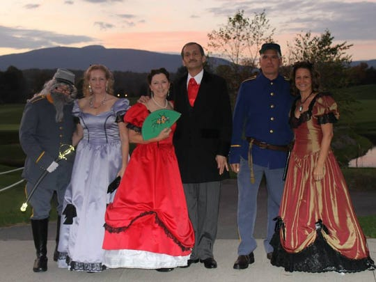 """Most attendees at the Vampire Ball wore costumes, including those with a """"Gone With the Wind"""" theme."""