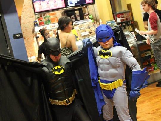 "A little Batman met a big Batman at a popular screening of Tim Burton's ""Batman"" (1989) at Robinson Film Center on Aug. 22."