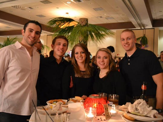 """Guests enjoy a bite to eat during last year's Passport to Paradise — """"Havana Nights"""" fundraiser."""