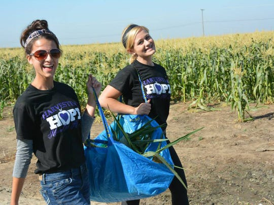 Brogan Cordeniz, left, and Michelle Silva at the Harvesting Hope Kick-off event that took place Sept. 6. Roughly 200 students and community members came out to the Tulare FFA facility and picked 15,000 pounds of sweet corn within roughly three hours for the hungry in Tulare County.