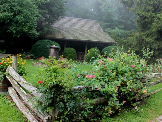 Rustic cottages dot the lush emerald lawn of The Swag
