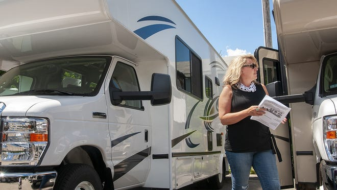 Jodi Diman of Holden shops for a recreational vehicle at Fuller RV and Sales in Boylston on Friday.