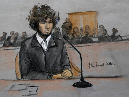 Boston Marathon bombing suspect Dzhokhar Tsarnaev sits in federal court in Boston for a final hearing before his trial begins in this sketch from December 2014.