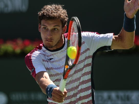 Pablo Carreno Busta, of Spain, hits his approach shot