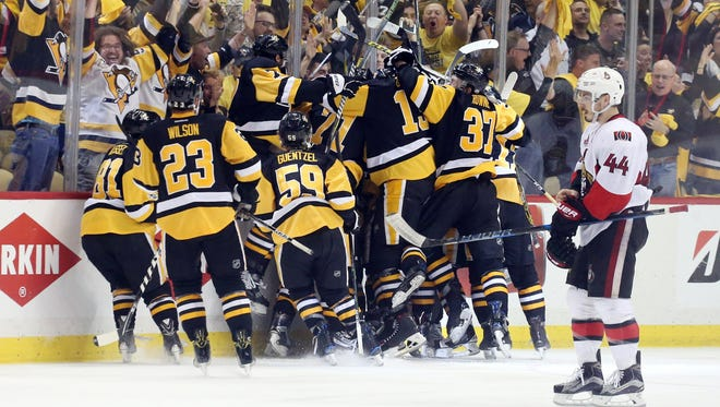 The Pittsburgh Penguins celebrate winning the Eastern Conference championship in double overtime.