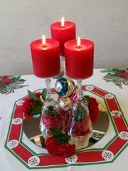 Wine glasses are at the heart of this holiday centerpiece.