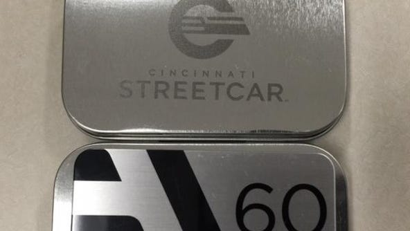 """A look at the streetcar's new logo and commemorative """"Founders' Club"""" fare card."""