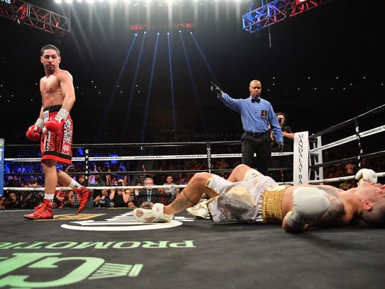 Danny Garcia, left, walks to the corner after knocking