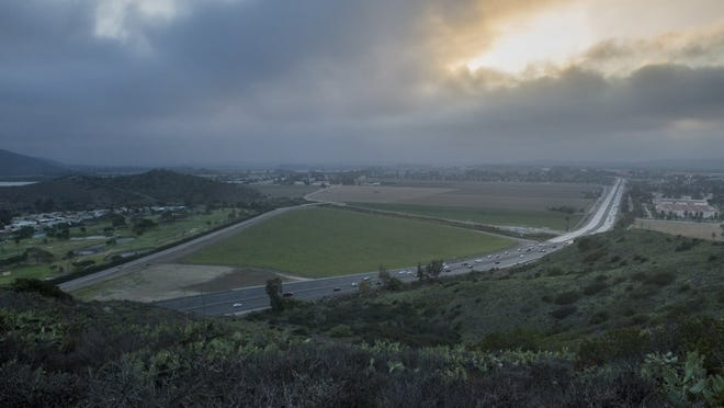Highway 101 passes by farmland at the base of the Conejo Grade.