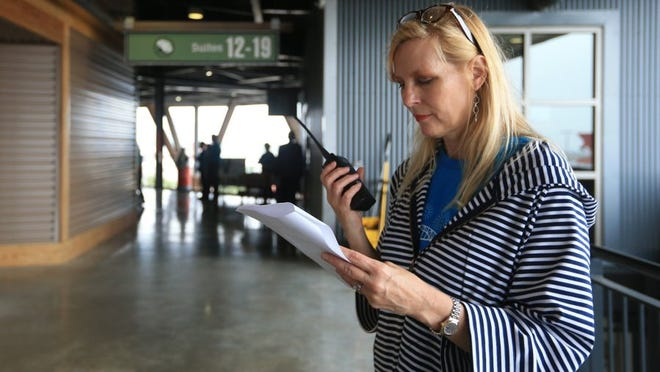 Rachel Denny Clow/Caller-Times Lynn Haueter listens in to make sure all aspects of the event are being covered during the VIP event at Pops in the Park on Saturday, April 16, 2016, at Whataburger Field. Haueter is the new executive director for the Corpus Christi Symphony Orchestra.