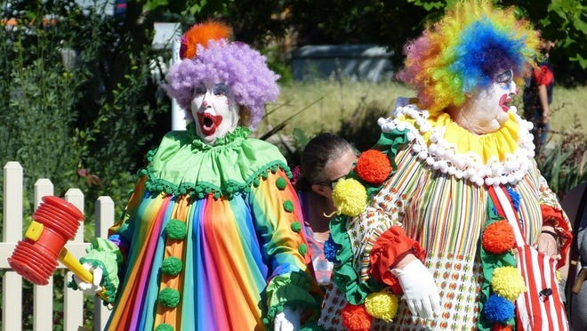 The Clowning Around Ladies entertain attendees Saturday during the Boomtown Festival in Shasta Lake.