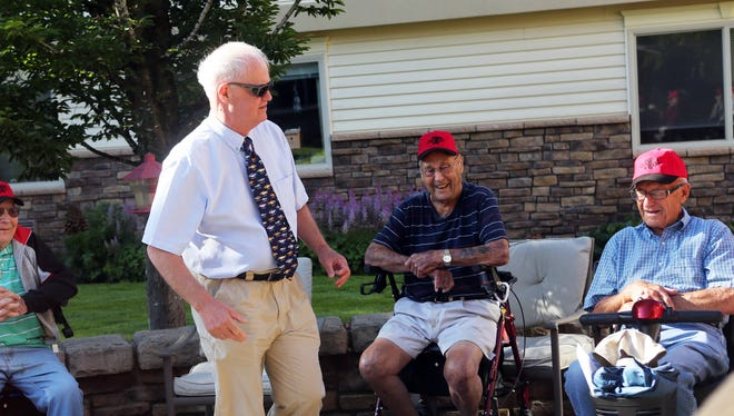 """Sen. Peter Courtney (standing) meets with Glenn Lucas (left), 97, Ed Schilling, 94, and Charles Minor, 95, some of the five """"Sidewalk Superintendents"""" at Cascade Park Retirement Community in Woodburn."""