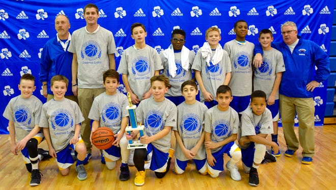 The 5th-6th grade boys basketball team from Our Lady of Sorrows captured the Catholic Central Christmas tournament title.  Russ Zarras is the team's head coach.