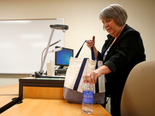 Adjunct faculty member Shirley Maurer packs up her things after teaching an algebra 1 class on Wednesday in the West Classroom Complex at San Juan College in Farmington.