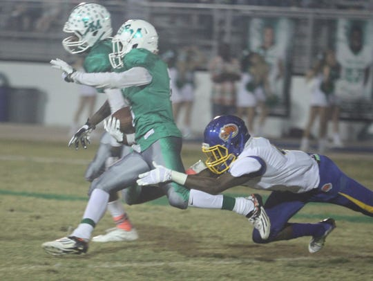 Ransy Smith runs the ball as Fort Myers takes on Clewiston