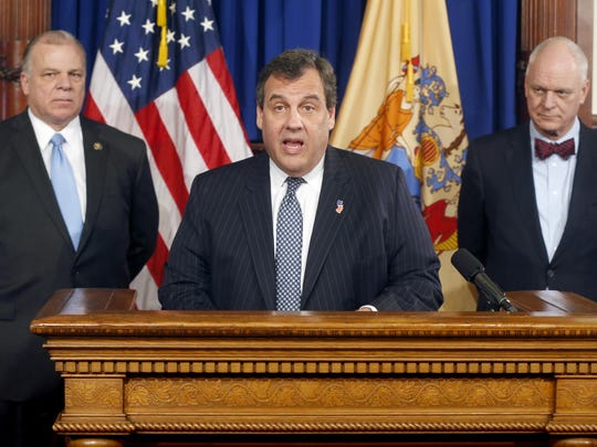 New Jersey Gov. Chris Christie, center, speaks during a press conference at the Statehouse with Senate President Stephen Sweeney, left, and Atlantic City Mayor Don Guardian in Trenton, N.J., Tuesday, Jan. 26, 2016. Christie said Tuesday the state will assume vast control over Atlantic City's finances and decision-making, saying the seaside gambling resort is incapable of getting its finances together after years of overspending.