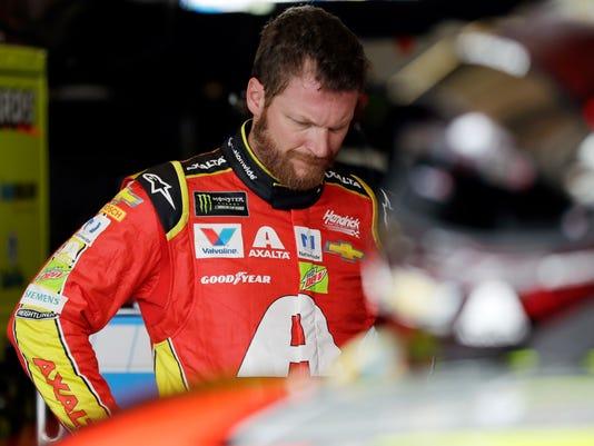 Dale Earnhardt Jr. looks over his car after practice for Sunday's NASCAR Cup Series auto race, Saturday, Aug. 5, 2017, in Watkins Glen, N.Y. (AP Photo/Matt Slocum)