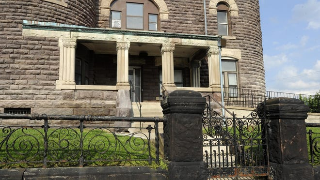 The historic Licking County jail is being cleaned by Coon Restoration and Sealants. In this photo, take on July, 1, the fence in front of the jail had yet to be cleaned and is a similar color to the jail before cleaning.