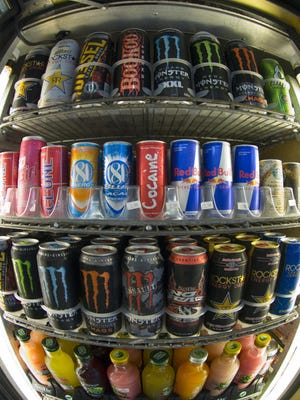Cans of energy drinks are displayed in a store in San Diego, Calif.