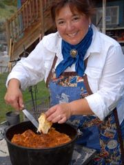 Dutch oven cooking expert Terry Bell serves Parmesan-crusted rolls hot off the coals.