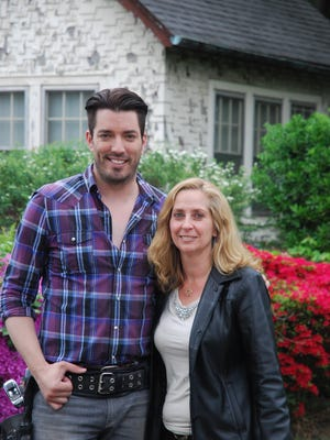 """Jonathan Scott, one half of """"The Property Brothers,"""" with real estate agent Agnes Seminara-Holzberg in front of the Eastchester house that was featured on the hit HGTV show."""