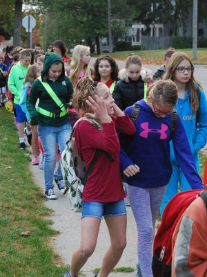 Students from Eddy Elementary School in St. Clair walk to school Wednesday. The school was celebrating Walk to School Day.