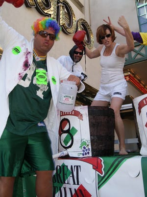 Bill Schulz, in gay pride wig, and Connie Wray, with Hellboy red fist, are Alice 96.5 FM radio personalities and experienced competitors in the Eldorado Great Italian Festival grape stomp.