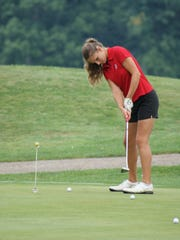 Shelby sophomore Claire Korbas works on her putting.