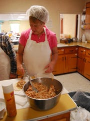 Peggy Sehlmeyer fills pasties at First Congregational Church in New Baltimore.