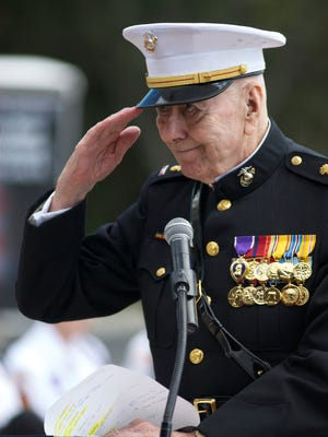 Retired Chief Warrant Office Walter L. Dugan, 88, of Cape Coral, salutes surviving area soldiers who were on Iwo Jima when the U.S. flag was raised 71-year-ago.