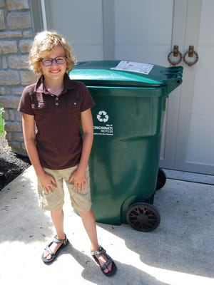 Hyde Park School fourth-grader Caden Elrod has spearheaded an effort to have recycling containers installed in Hyde Park Square.