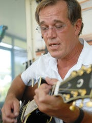 07/21/2009--Photo by Craig Bailey/Florida Today--William Dillon plays guitar on the porch of his home in Satellite Beach.