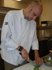 Steve Anderson, head chef at Henke Wine, cuts a locally