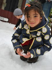 Kendall Nagaoka plays in the snow during a past Arctic