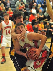 Lane Seymour of the Chinook Sugarbeeters, in white, looks to score around Laurence Allderice of Big Sandy in a 2015 game.