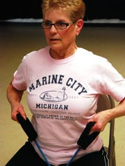 Susan Schoen works out with rubber tubes at the Washington Life Center in Marine City. The Casco Township woman plans to swim the Straits of Mackinac on Labor Day.