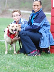 Dutchess Day School sixth-grader Bjorn Bowser poses with his mother and the family's best friend at the dog walk.