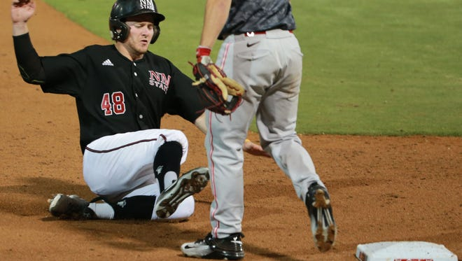New Mexico State's Cameron Haskins slides safely into third  base Tuesday.