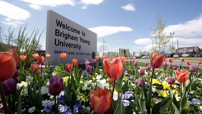 In this Tuesday, April 19, 2016, a welcome sign to Brigham Young University sits at the school in Provo, Utah. BYU students who say they were sexually assaulted are finding themselves under investigation for possible violations of the Mormon school's code against sex and drinking. BYU says it will re-evaluate the practice.