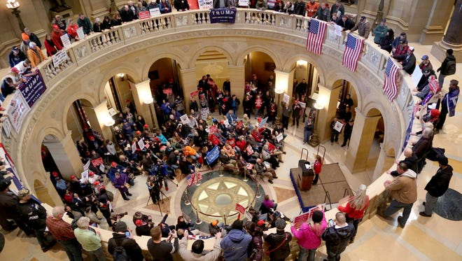 A national March 4 Trump brought out a large crowd in support of President Donald Trump to the State Capitol rotunda Saturday, March 4, 2017, in St. Paul.